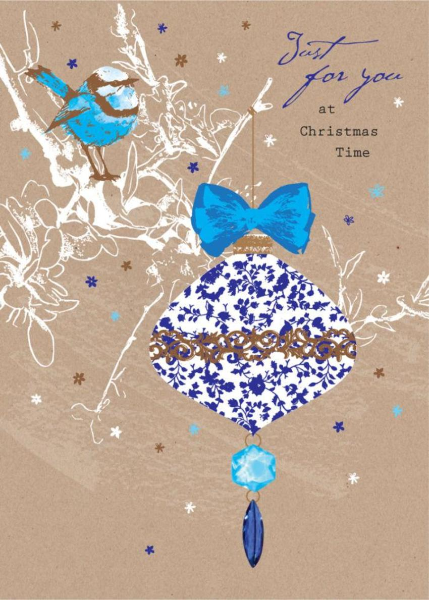 Christmas Bauble And Blue Bird On Brown Paper