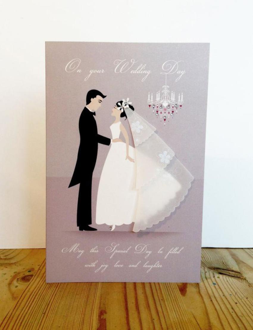 Wedding couple and chandelier.jpg